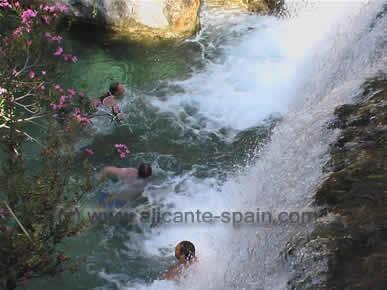 Swimming in the waterfall.